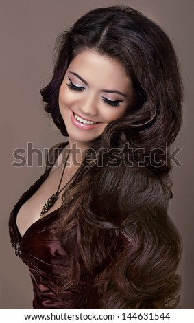 Hair. Fashion style. Happy Smiling Brunette Girl. Healthy Long Hair. Beauty Model Woman. Hairstyle - stock photo