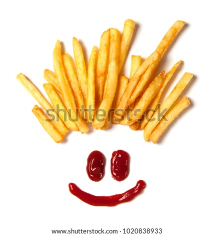 Hair from potatoes. French fries  and a face with a smile from ketchup isolated on white background