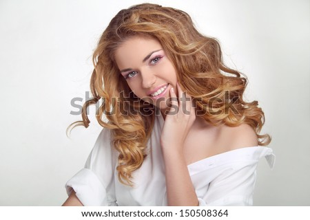 Hair. Happy Smiling Girl Enjoying the freshness. Beauty Woman with Long Healthy and Shiny Wavy Hair.