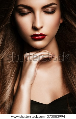 Hair, healthy long hair, hairstyle, make up. Portrait of young woman with red lips