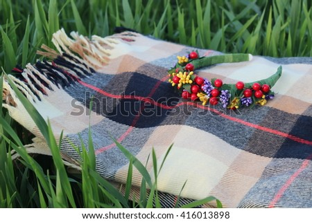 Hair hoop on a plaid blanket and green grass