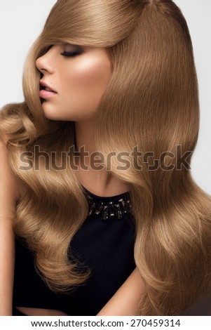 Hair. Portrait of beautiful Blonde with Long Wavy Hair. High quality image. - stock photo