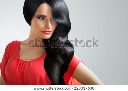 Hair. Portrait of Beautiful Woman with Black Wavy Hair. High quality image. - stock photo