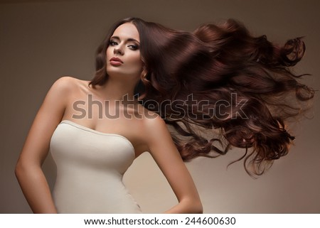 Hair. Portrait of Beautiful Woman with Long flying Hair. High quality image. - stock photo