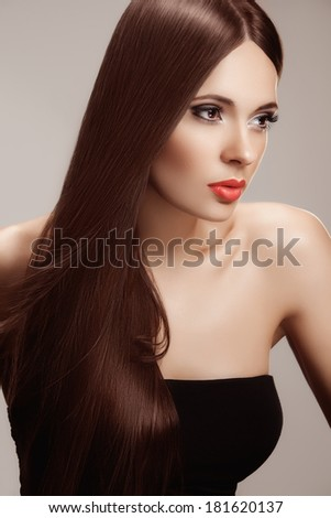 Hair. Portrait of Beautiful Woman with Long Hair. High quality image.