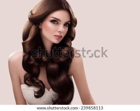 Hair. Portrait of Beautiful Woman with Long Wavy Hair. High quality image.