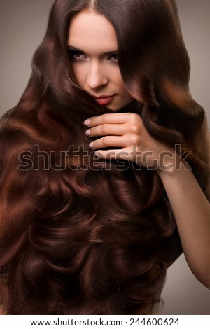 Hair. Portrait of Beautiful Woman with Long Wavy Hair. High quality image. - stock photo
