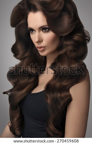 Hair. Portrait of Beautiful Woman with Wavy Hair. High quality image. - stock photo