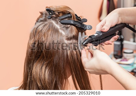 Hair extensions stock images royalty free images vectors hair salon beauty spa procedure of hair extensions pmusecretfo Choice Image