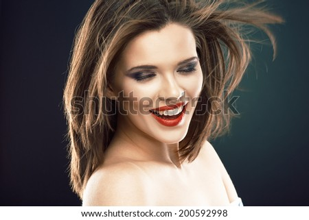 Hair style smiling woman portrait. Female model with long hair in motion.