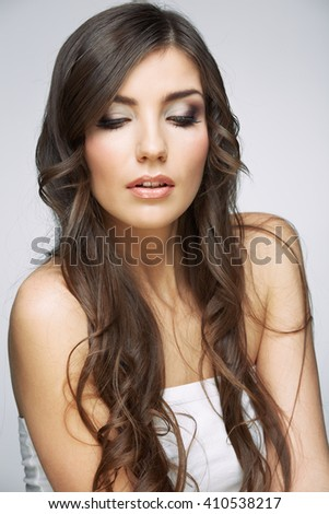 Hair style young woman portrait.Female model studio posing.
