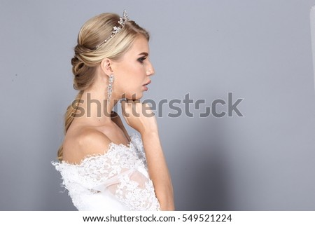 Hair Styling Rear View, blonde color caucasian bride hair style, White Wedding Lace Dress beauty shoot, studio lighting gray background