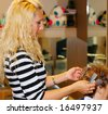 Hair stylist working very fast with her fingers - stock photo