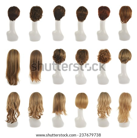 Hair wig over the white plastic mannequin head isolated over the white background, set of multiple different wigs in the back foreshortening - stock photo