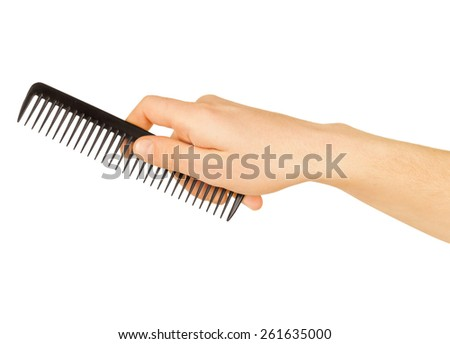 hairbrush in the hand isolated on white  - stock photo