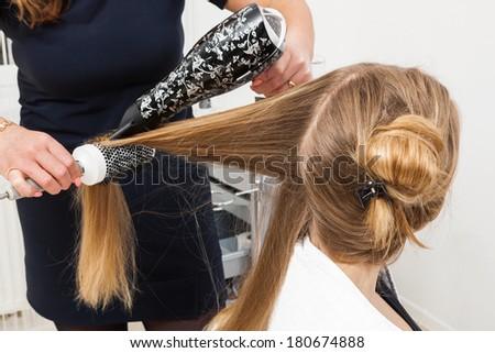 hairdo in a modern hair salon - stock photo