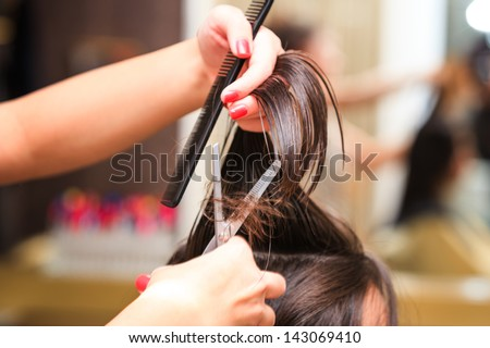 hairdresser do haircut close up indoor shot - stock photo