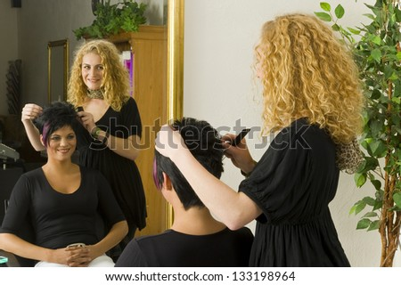 hairdresser is cutting a stylish haircut