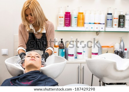 Hairdresser salon. Woman during hair wash - stock photo