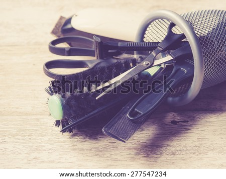 hairdresser tools on white wood,vintage color toned image - stock photo