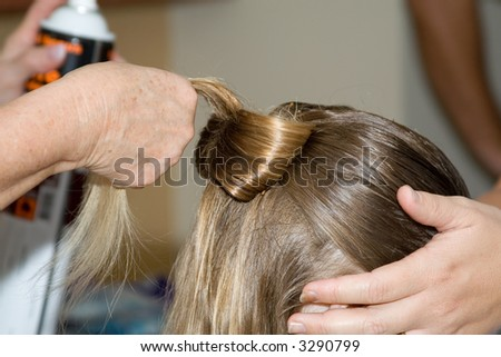 Hairdressers doing a knot hairstyle