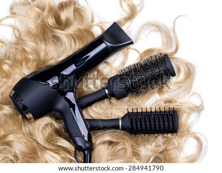 hairdressers  tools on a background of the  blond hair