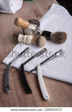 hairdressing equipment like razor and  brush and mousse and  towel  in  professional  hairdressing salon