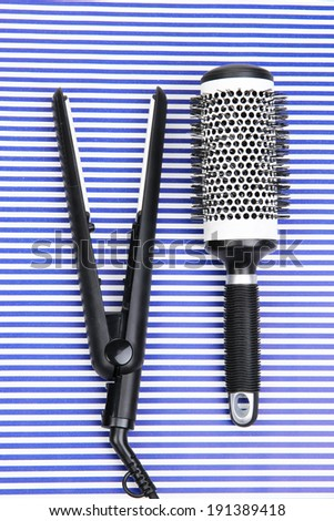 Hairdressing tools on striped blue background - stock photo