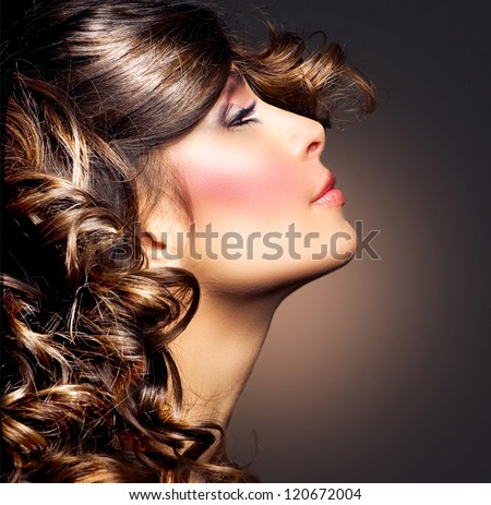 Hairstyle.Curly Hair.Beauty Woman Portrait.Brunette Girl. Beautiful Girl's Face closeup - stock photo