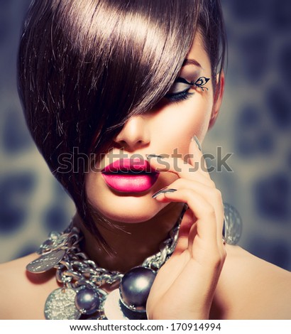 Hairstyle. Fringe. Haircut. Beauty Sexy Model Girl Portrait with Perfect Makeup and Manicure. Healthy Smooth Skin. Make up. Diamond Collar Accessories. False Eyelashes  - stock photo