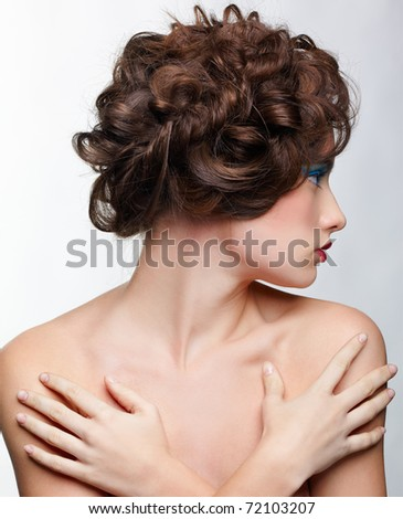 hairstyle portrait of beautiful brown-haired girl with creative hairdo - stock photo