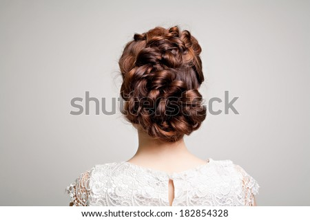 hairstyle portrait of beautiful brunette girl with creative braid hairdo in white dress  - stock photo