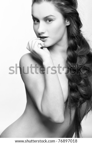 hairstyle portrait of beautiful surprised brunette girl with creative braid hairdo - stock photo