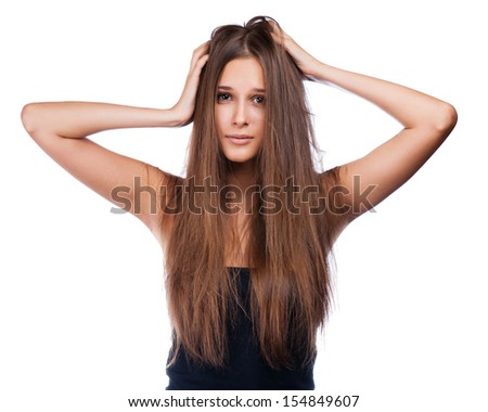 hairstyle portrait of shocked; beautiful brunette girl with creative braid hairdo looking at splitting ends