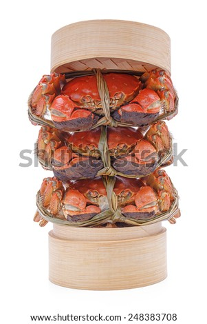 Hairy crabs on the Bamboo steamer Isolated on white background - stock photo