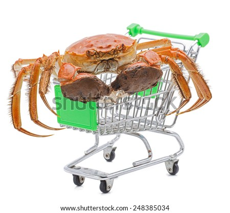 Hairy crabs on the shopping cart isolated in white background. - stock photo