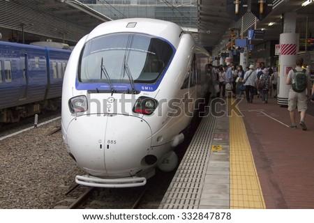Hakata train station. Japan - 30.08.2015: 885 Intercity Limited Express Train by Kyushu Railway Company. Fukuoka to Nagasaki.  - stock photo