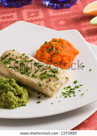 Hake filet with carrots and broccolis purees in an elegant dinner plate