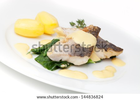 Hake with chard hollandaise sauce potatoes