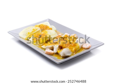 hake with shrimp and potatoes with yellow sauce - stock photo