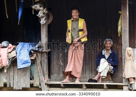 HAKHA, MYANMAR - JUNE 19 2015: Local men smiling in the Hakha region in Chin State, Myanmar. - stock photo