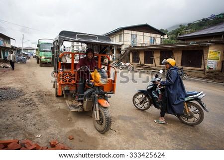 HAKHA, MYANMAR - JUNE 19 2015: Local tuk tuk transportation in the Hakha region in Chin State, Myanmar. - stock photo