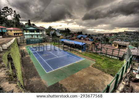 HAKHA, MYANMAR - JUNE 19 2015: Tennis arena in remote town of Hakha in the recently opened to foreigners area of Chin State - western Myanmar (Burma) - stock photo