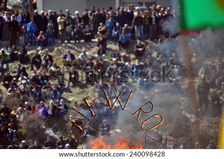 HAKKARI,TURKEY - MARCH 21: Kurds celebrating their traditional feast Newroz that means 'new day' in kurdish on March 21, 2010 in Hakkari, Turkey.