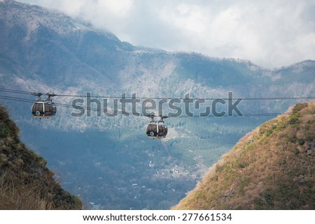 Hakone, Tokyo, Japan - April 21, 2015: Hakone Ropeway operates from Sounzan Station to Togendai Station, allows visitors to take in spectacular views as the crystal-clear blue waters of Lake Ashi  - stock photo