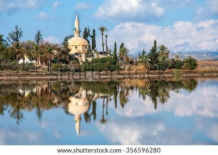 Hala Sultan Tekke or Mosque of Umm Haram is a Muslim shrine on the west bank of Larnaca Salt Lake in Cyprus. - stock photo