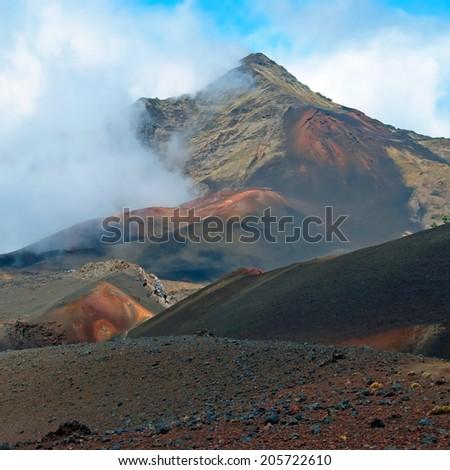 Haleakala crater with trails in Haleakala National Park on Maui Island Hawaii panorama - stock photo