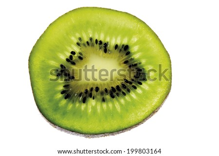 Half a kiwi fruit, close-up, elevated view - stock photo