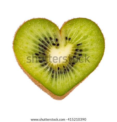 Half a kiwi fruit in heart shape on white background - stock photo