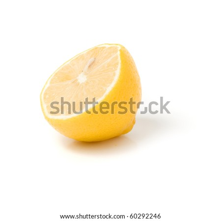 Half a lemon on a white background. - stock photo